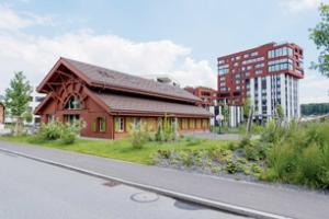 Quelques rares bâtiments restaurés témoignent du passé industriel de l'endroit. [©Zug Estates]