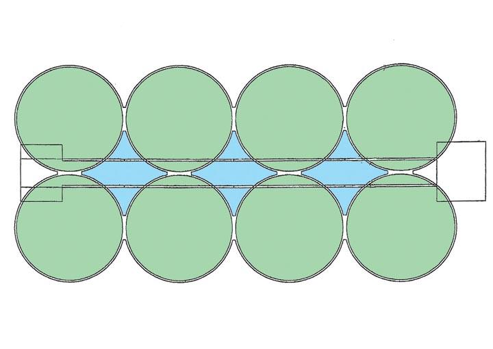 """Figure 1 - L'ouvrage est constitué de 8 cylindres en béton en béton de 13 m de diamètre et de 45 m de hauteur (identifiés en vert) et 3 en forme """"d'as de carreau"""" (identifiés en bleu). L'ensemble formant 11 silos à grains."""